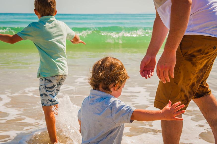 dad-and-boys-in-waves-josie-gritten.jpg