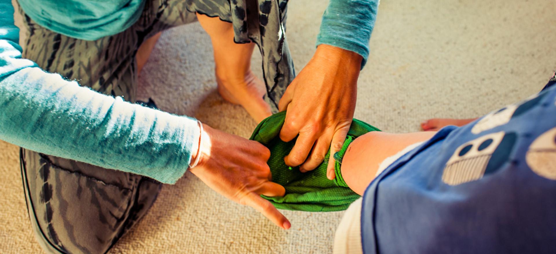 mum-helps-toddler-with-pants-josie-gritt
