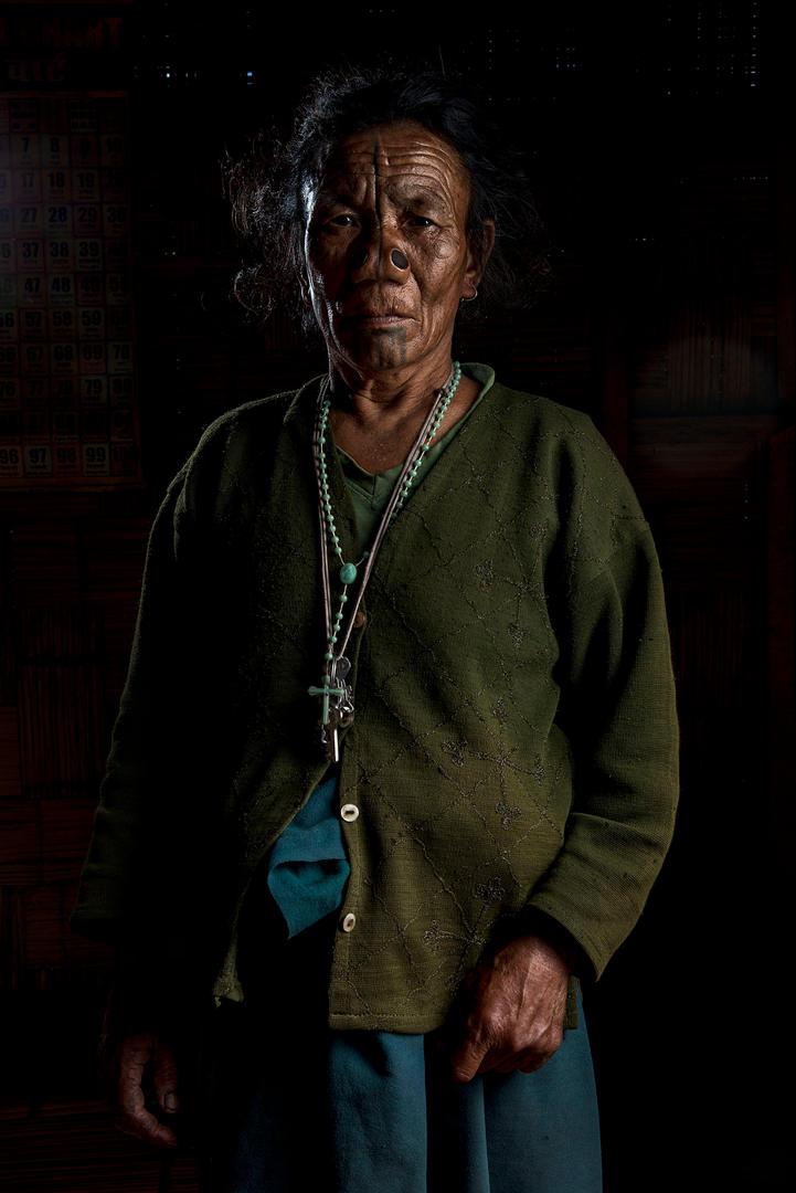 Budhi Yarang, 60's. She lives in Hong Village, Ziro, India.