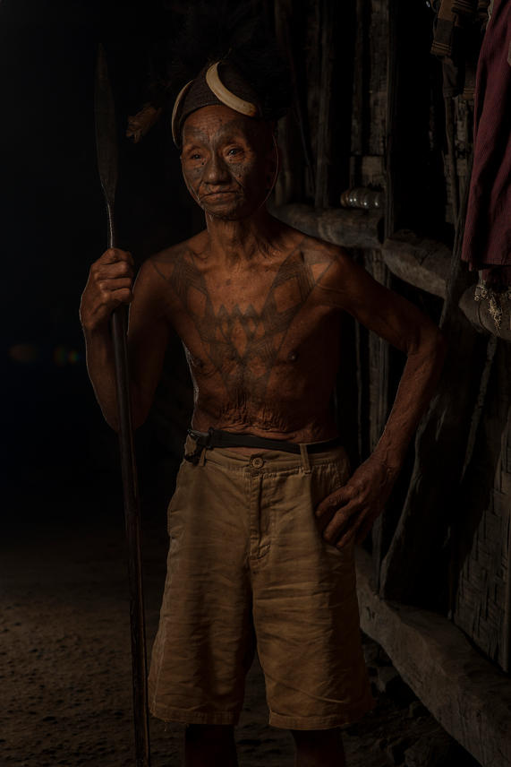Chopa, 79, taken 2 heads. He is from the Longwa Village, Mon District, Nagaland, India.