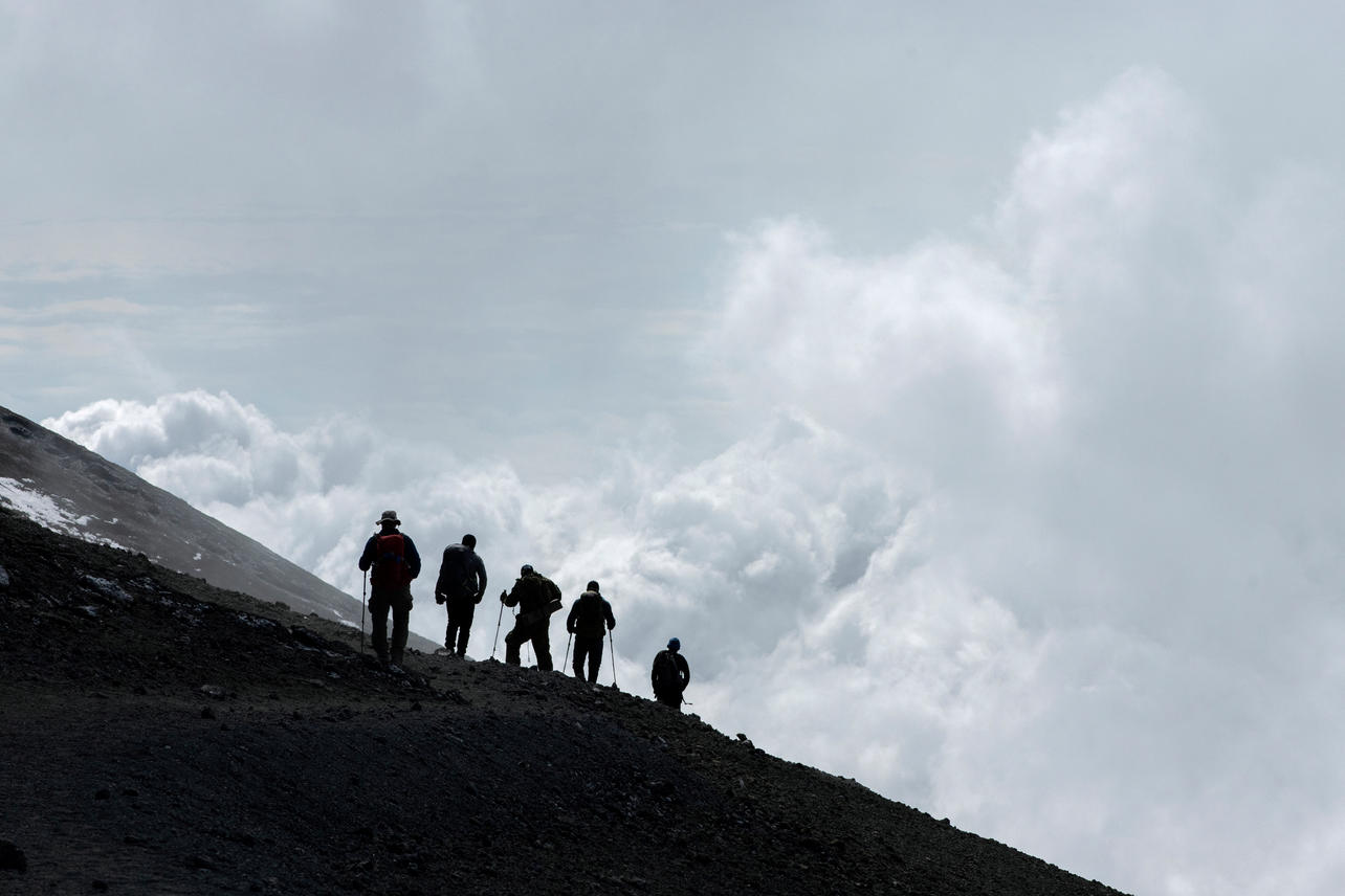 KCC team members make their way down Mount Kilimanjaro after reaching the summit on August 10, 2021 during day seven of an eight-day climb to summit Mount Kilimanjaro.