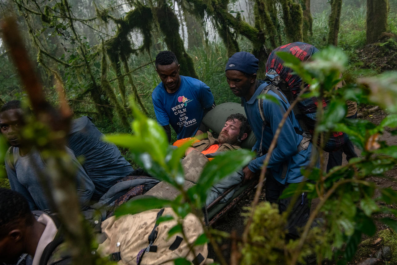 Guides give Noah Galloway a ride down the mountain and through the rain forest on August 11, 2021 during their last day of an eight-day climb to summit Mount Kilimanjaro. Nine of the twelve KCC team members summited the mountain at 8:15 am the day before.