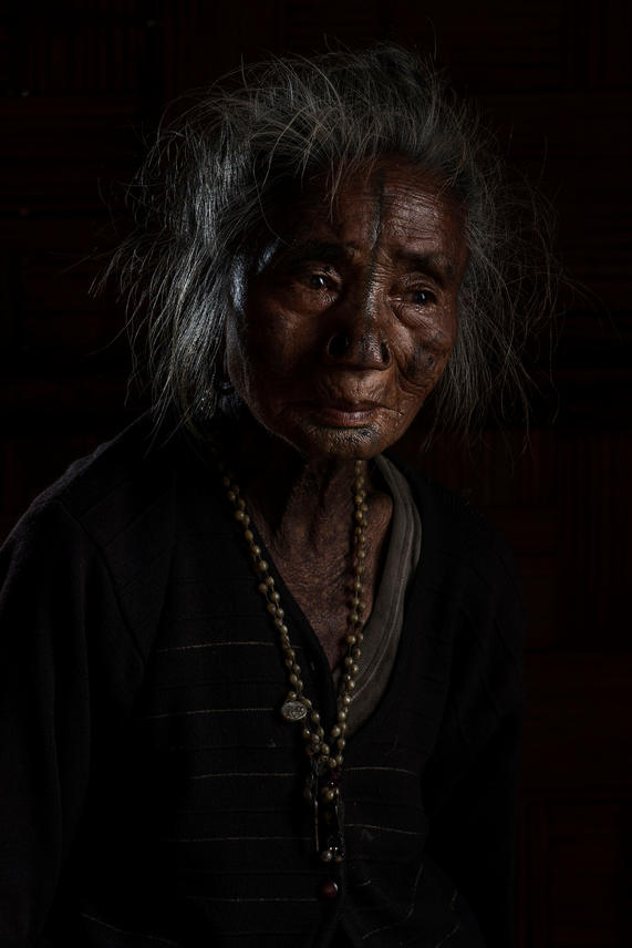 """Kago Yapii, 70's. She lives in Hong Village, Ziro, India.  When Yapii was five or six she had her modifications done. She says, """"I really wanted to have this done and I had no fear at all""""."""