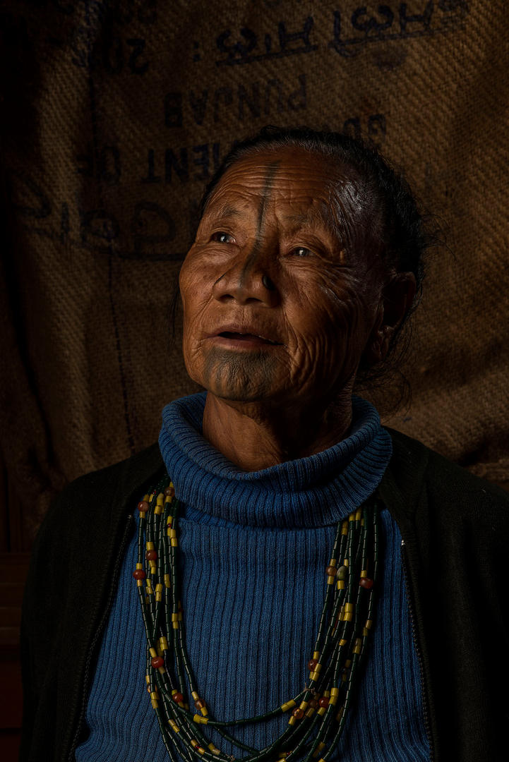 Tilling Mope, 65. She lives in Hong Village, Ziro, India.