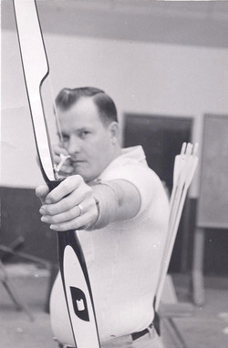 Leroy Aiming his Bow While Shooting Recreationally