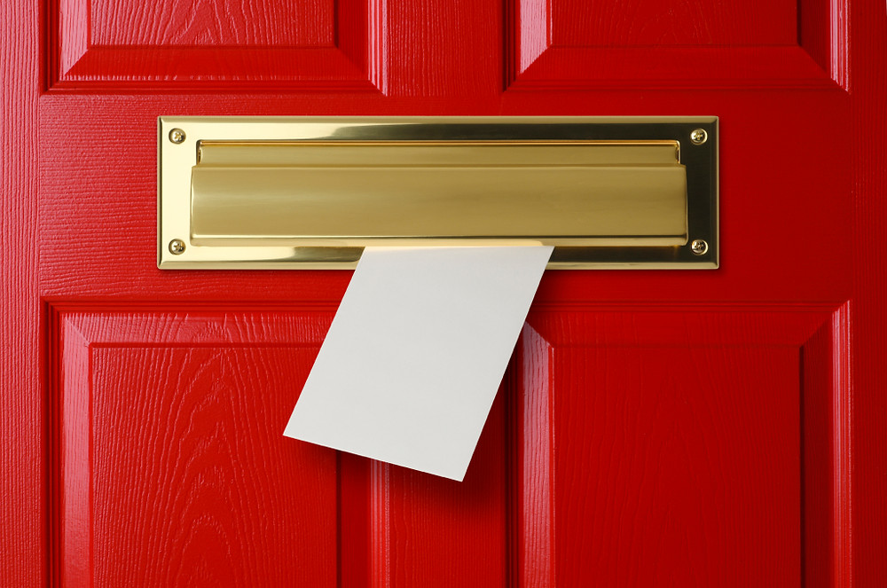 red door with mail slot blog