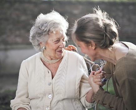 elderly woman with caretaker.jpg