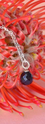 onyx amulet on flower.jpg