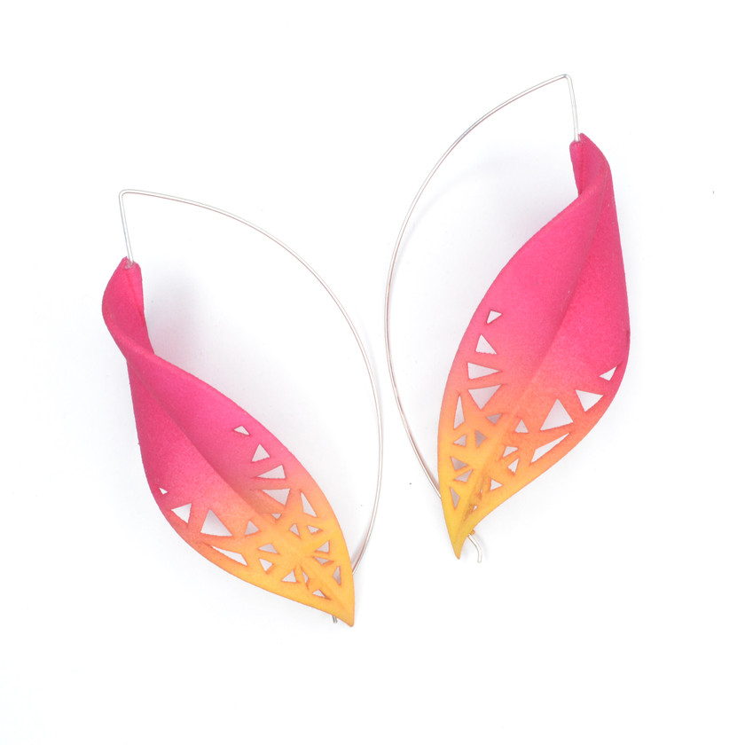 Oversize tropical earrings in pink and yellow colour, super light on the ear. These sensual earrings are inspired by orchid petals and are a real show stopper