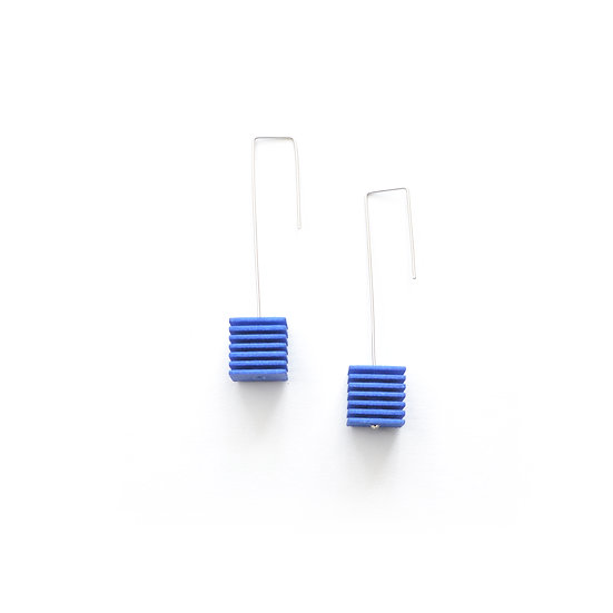 cobalt blue statement earrings with striped cubes
