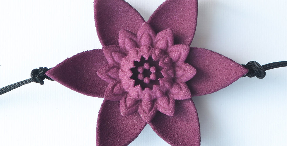 luxury fashion designer bracelet with large flower in plum mauve purple colour