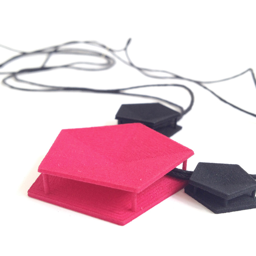 Match your minimal style with this adjustable lightweight necklace in black and magenta innovative 3D printed nylon plastic