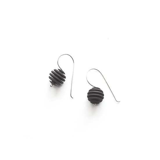 black optical dangle earrings