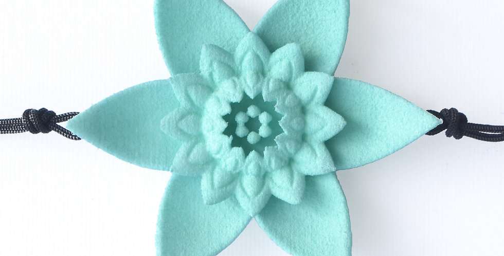 luxury fashion designer bracelet with large flower in pastel aqua blue colour