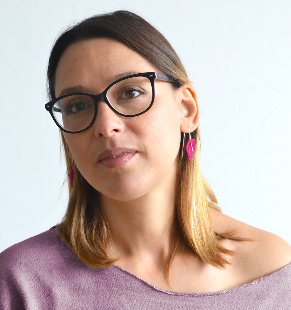 Hot pink asymmetrical drop earrings with glasses