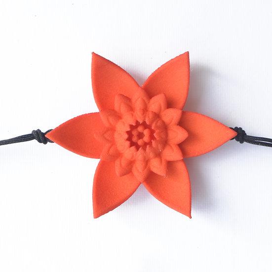 designer single flower bracelet handcrafted in warm tangerine orange