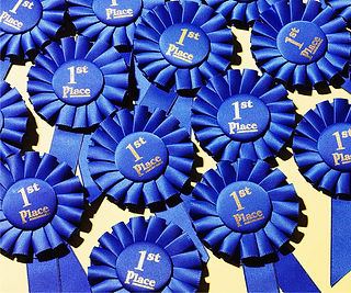 RIBBONS-BLUE-1ST-PLACE-ROSETTES.jpg