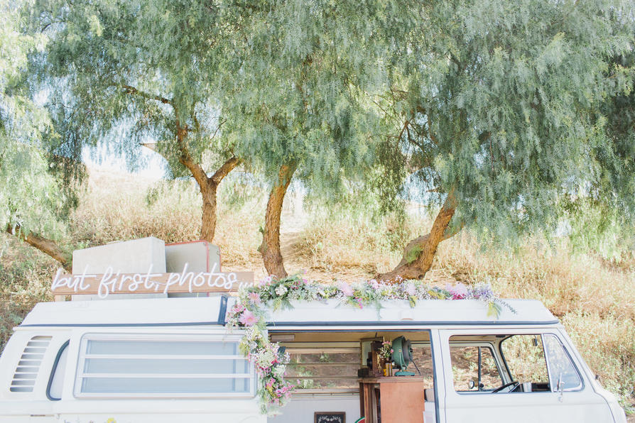 The White Photo Bus with Flowers