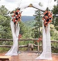 Black Hills Rally Weddings log motorcycle wedding arch.