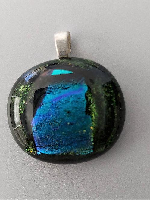 Teal dichroic pattern on aventurine green glass