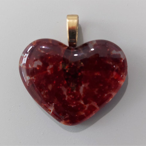 Dark red and clear glass heart