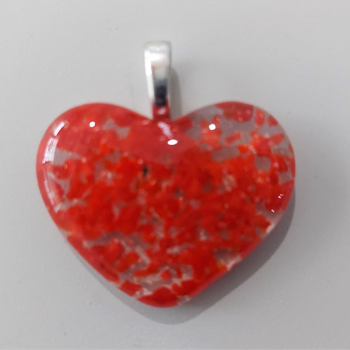 Bright red and clear glass heart