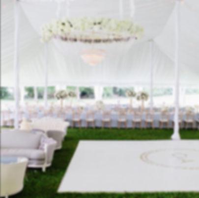 Chandelier over White Dance Floor in tent