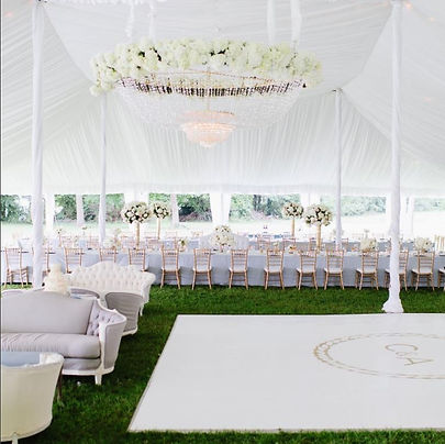Chandelier over White Dance Floor in tent