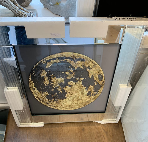 Gold and Black Globe on Mirrored Frame