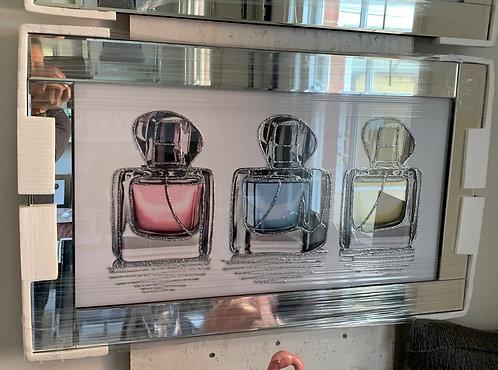 3 Perfume Bottles on Mirrored Frame