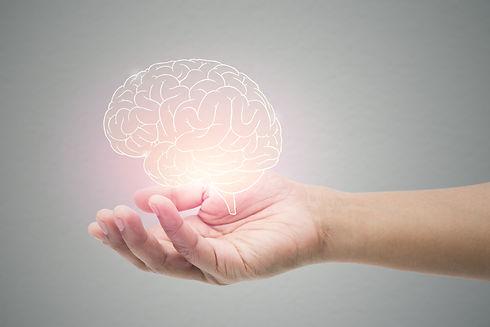 Man holding brain illustration against g