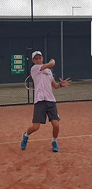 13yo Kostic FH follow through.jpg