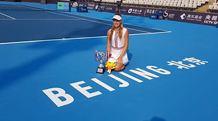 Amy sitting with Beijing Trophy.jpg