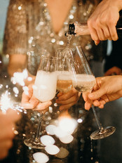 person-pouring-champagne-on-champagne-flutes-3171770.jpg