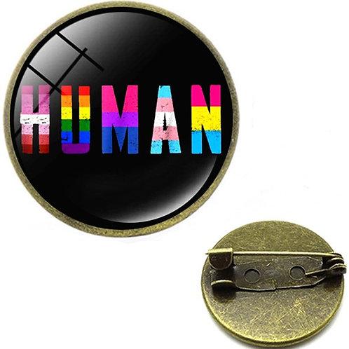 Human Glass Domed Lapel Pin