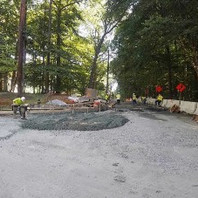 Contractor formed PCC curb and gutter, wheelchair ramp and placed concrete.