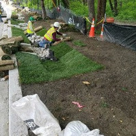 Contractor excavated and installed stone check dam, soil and sod for bioswale, LID7-3.
