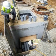 Contractor Prepared and installed Manhole Corner Recess at M18 and trench excavated to install conduits.