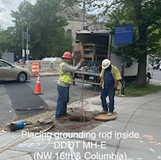 Placing grounding rod inside DDOT MH-E. (NW 16th & Columbia)