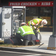 Pulling and charging the cabinet and pulling cables at WB Lebaum St, SE & SB MLK.