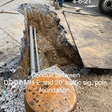 Conduit between DDOT MH-E and 20 traffic sig. pole foundation.