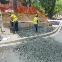 Contractor excavated, placed, and compacted GAB for placement of Exposed Aggregate Sidewalk.