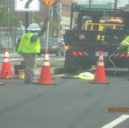 Pulling cables thru MH at NB MLK & Malcom X Ave, SE.