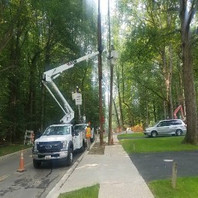 Other utility company on site to remove obstructed utilities and existing poles.