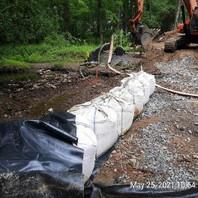 Contractor for the Bridge work began sandbag installation and adjustment.