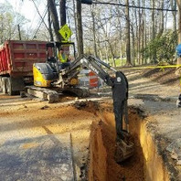 Contractor excavated trench for DCWATER work and prepped for tie-in activities.