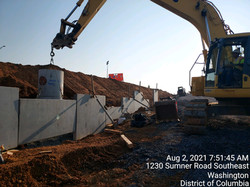 Erecting MSE wall panels along NB I-295 and Ramp F.