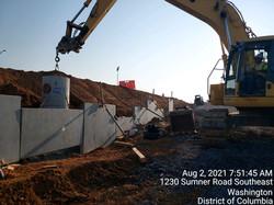 Erecting MSE wall panels along NB I-295 and Ramp F