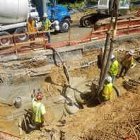 Contractor continued retaining wall #3 drilling and draining to clean caisson placed re-bar cage and pumped concrete.