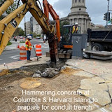 Hammering concrete at Columbia & Harvard island to prepare for conduit trench.